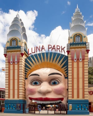 Luna Park Towers (1935)Sydney's Luna Park opened in October 1935 and is today a rare surviving amusement park featuring fantasy architecture in the art deco style of the 1930s. The first of the eight faces at the entrance to Luna Park was created in 1935 by Melbourne scenic artist Rupert Browne. He suspended a large austere face between the two art deco decorated entrance towers which were topped with stepped spires imitating the New York Chrysler building. It was not until 1960 that the first happy face, based on Old King Cole, was created by resident artist Arthur Barton.