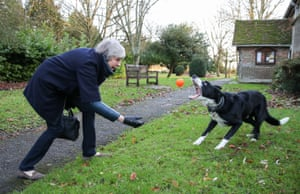 Maidenhead, UK: Theresa May throws a ball for Blitz, a border collie
