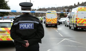 Police at the scene of a terrorism-related raid in Dewsbury, West Yorkshire