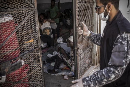 A guard closes the door of a cell in Abu Salim detention centre, in the Libyan capital Tripoli.