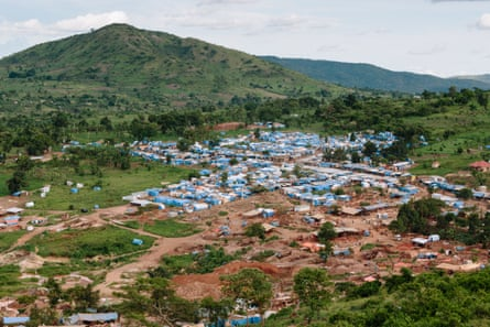 An aerial view of an artisanal mining complex in Uganda. The mining area is seen in the foreground.