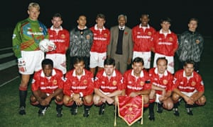 Paul Parker and the Manchester United team line up with Nelson Mandela before a friendly match in Johannesburg in July 1993.