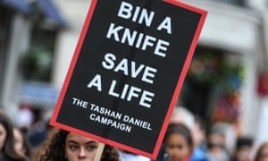 A sign at an anti-knives march