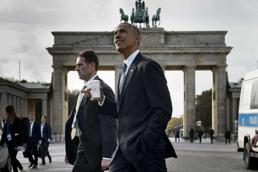 US President Barack Obama passes the Brandenburg Gate while walking from the US Embassy to the Adlon Hotel in Berlin, Germany.