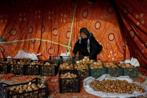 Ra'ad Abdelemir, a trader, sorts truffles in a tent at a market