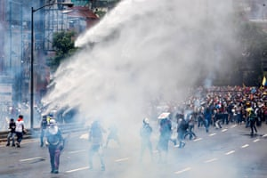 Police use water cannon in an attempt to disperse the crowds