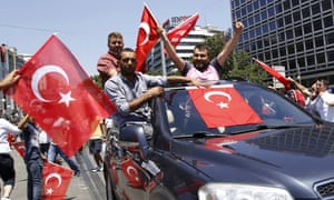 Supporters of Turkish President Tayyip Erdogan celebrate with flags in Ankara