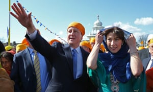 Prime Minister David Cameron and his wife Samantha take part the Vaisakhi Nagar Kirtan procession at Guru Nanak Darbar Gurdwara on in Gravesend.