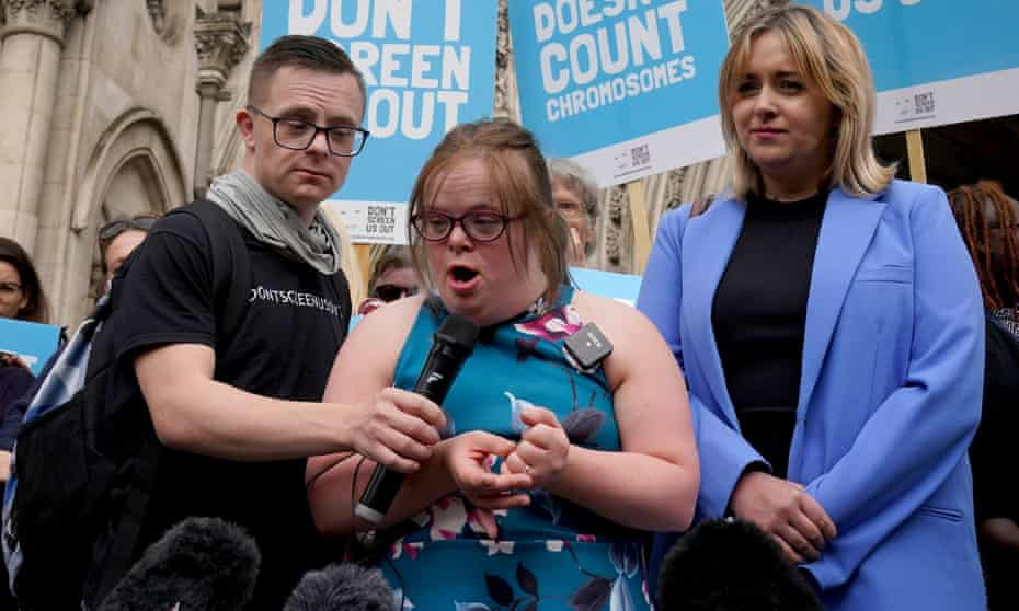 Heidi Crowter (centre) and Máire Lea-Wilson speaking to the media outside court in London
