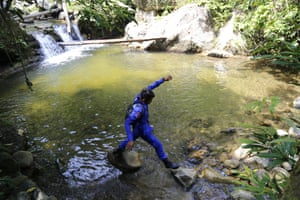 Seremban, Malaysia: A rescue worker looks for missing British teenager Nora Anne Quoirin