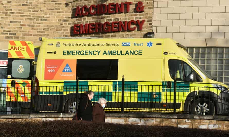 People walks past a accident and emergency department sign in front of an ambulance outside Bradford Royal Infirmary hospital