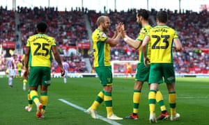 Teemu Pukki celebrates after putting Norwich 2-1 up. Stoke equalised but Leeds' defeat to Brentford means the Canaries are one point from a Premier League return.