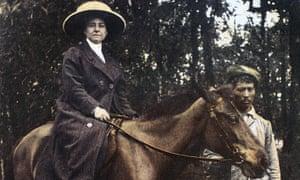Alexandra David-Néel on horseback, with Nepali holding bridle
