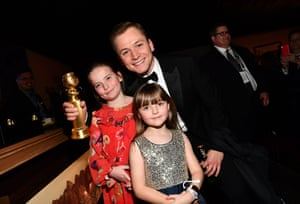 Taron Egerton poses with sisters Mary and Rosie