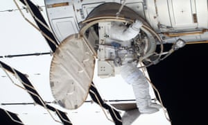 An astronaut climbs into the International Space Station