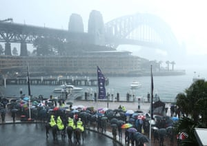 Grey skies and torrential rain greet Prince Harry at Campbell's Cove in Sydney
