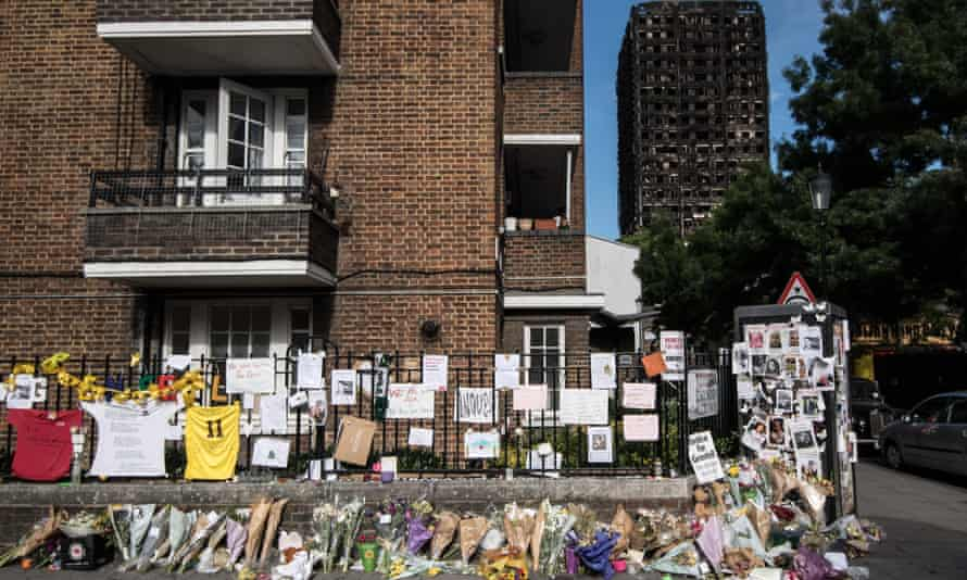 Flowers and tributes are left near Grenfell Tower on June 26, 2017 in London, England.