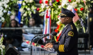 Dallas Police Chief David Brown, the author's stepfather, speaks during a funeral service on 16 July.