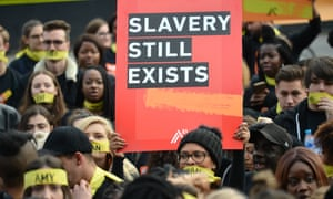People march against modern slavery through London wearing face masks representing the silence of modern slaves in forced labour and sexual exploitation on 14 October 2017 in London.