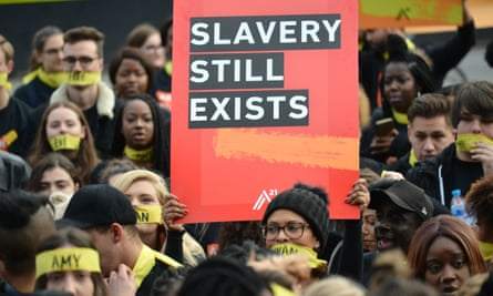 Activists march in London to protest against modern slavery.