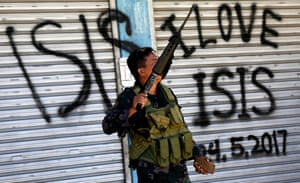 A Filipino soldier patrols an area of Marawi city reclaimed from the Maute Group in 2017.