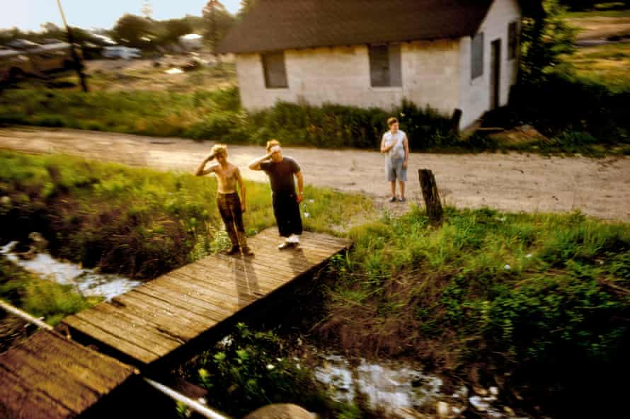 A father and son salute Robert F Kennedy's funeral train, 1968.