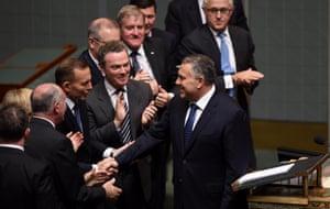 Prime Minister Tony Abbott (left) congratulates Joe Hockey.