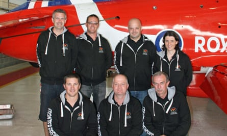 The Frontier Fireworks team pose for a photo in front of one of the Red Arrows planes, in 2014. Chris is back left.