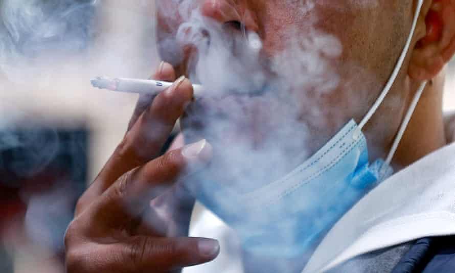 A Jordanian man smokes a cigarette
