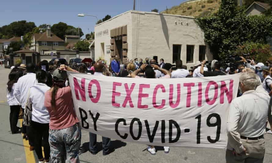 People listen to a news conference outside San Quentin state prison in California on 9 July. Daniel Ruiz, who was housed at San Quentin, died on 11 July.