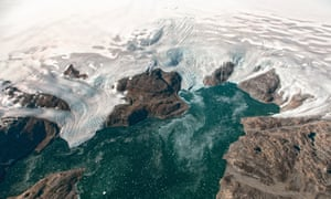 Aerial surveys show two glaciers flowing into Johan Petersen fjord in south-eastern Greenland. The melting of the ice sheet would cause oceans to rise by six metres around the world if it was lost entirely.