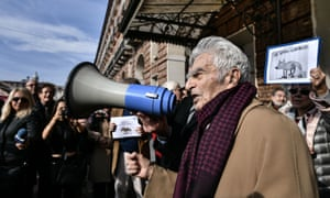 100-years-old Italian journalist, lawyer and politician, Bruno Segre speaks with a megaphone in Turin on Tuesday.