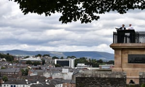 Julian Smith (L) looks out from Derry's walls over the Bogside alongside William Moore (R), chairman of the Siege Museum on his first official engagement in Northern Ireland.