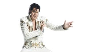 An Elvis impersonator dancing