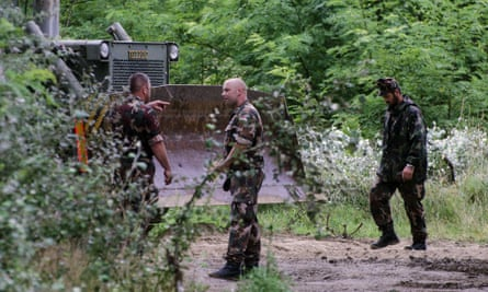Hungarian soldiers prepare the ground for construction of the first section of the country's border fence