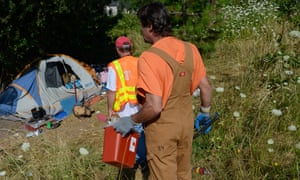 Inmates in Oregon are provided with gloves, tongs and biohazard boxes to protect themselves from exposure to dirty needles and other hazards while cleaning up homeless camps.