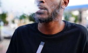 A man uses a Juul vaporizer in Atlanta.