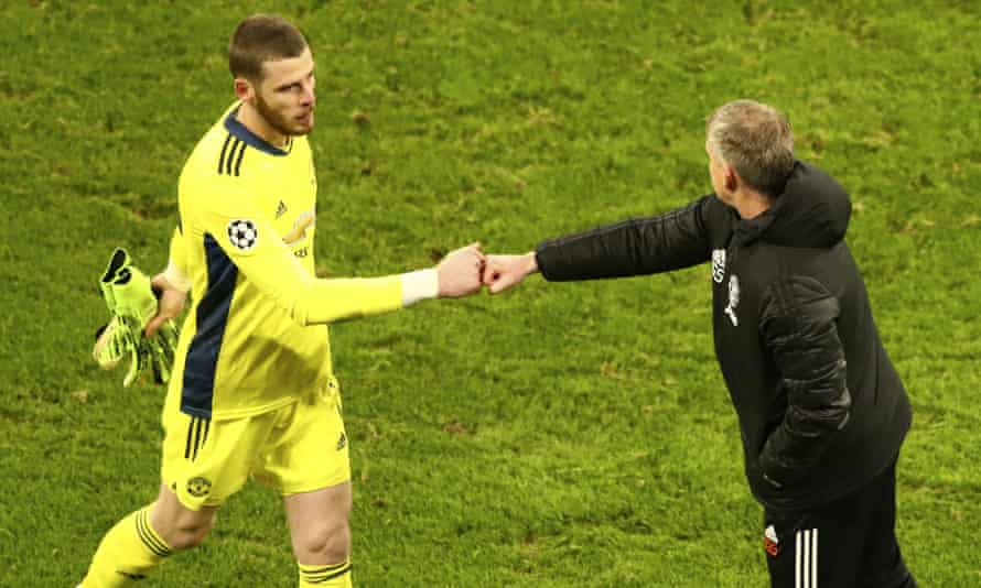 David de Gea (left) has been backed by Ole Gunnar Solskjær. Here they bump fists after Manchester United's Champions League exit at Leipzig.
