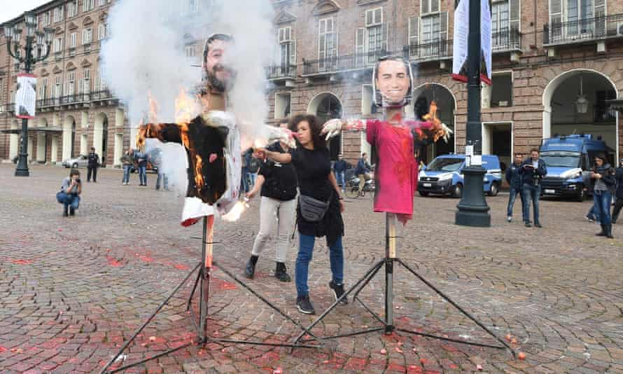 Italian students burn effigies of the League party's Matteo Salvini and his coalition partner, M5S's Luigi Di Maio, to protest against the government's spending plans.