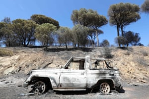 The wreckage of a burnt car following a fire in Ramatuelle