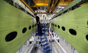 An employee inspects a wingbox section for an Airbus SAS aircraft