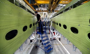 A GKN worker inspects a wingbox section for an Airbus SAS aircraft
