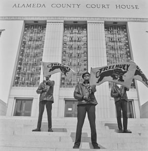Pirkle Jones, Three men carrying Free Huey banners on court house steps, #71 from A Photographic Essay on The Black Panthers