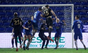 Craig Dawson (No 15) rises highest to send a fine header into the Stockport County net and send West Ham through to the fourth round of the FA Cup.
