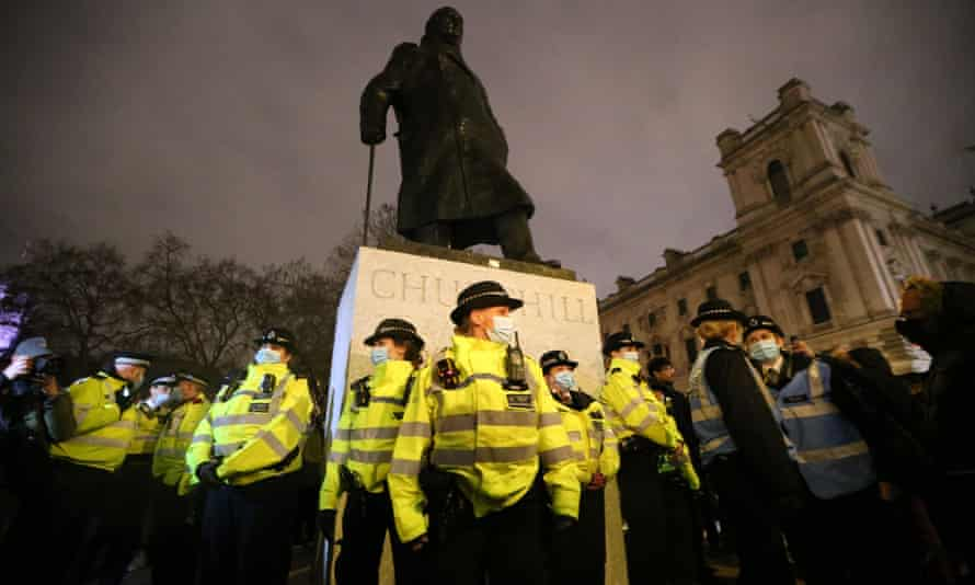 Police gather to protect the statue of Winston Churchill during Sunday's protest in Parliament Square organised by Sisters Uncut.
