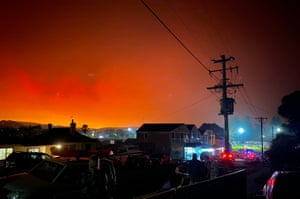 The darkened sky glowing orange from bushfires many kilometres away at 735am from the coastal town of Bermagui in the Australian state of New South Wales. -