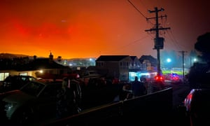 This photo by Caitlin Nobes shows the darkened sky glowing orange from bushfires many kilometres away at 7.35am from the coastal town of Bermagui in New South Wales.