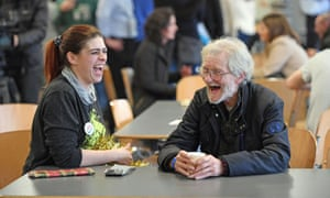 A volunteer with a homeless visitor at a Crisis at Christmas centre in London