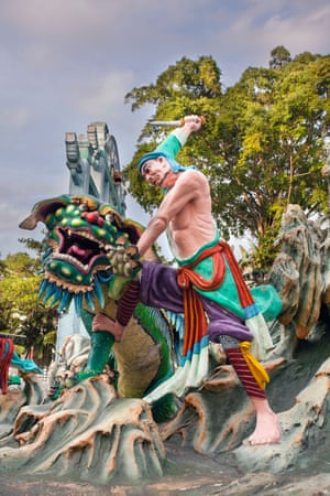 A traditional representation of Chinese warrior Wu Song slaying a tiger in Haw Par Villa theme park, Singapore