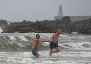 Swimmers brave the snowy conditions at King Edward's Bay near Tynemouth